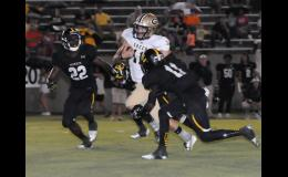 Mario Cusano scrambles for a few yards during a 28-22 win over Union County on Friday night. The Yellow Jackets are now 3-0.