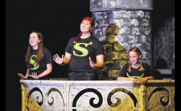 The  character of Fiona is played by three actresses representing various ages of the princess over the course of her time locked away in a castle. Pictured, left to right, are Ashley Wettlan, Sarah Hurley and Camila Escobar.