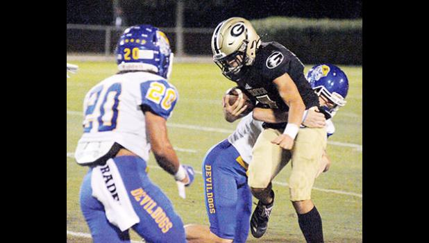 Travelers Rest managed to keep Greer winless at Dooley Field last Friday night, taking down the Yellow Jackets, 21-14.