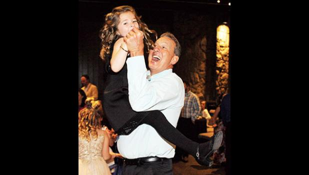 Paul Burgess shares a dance with his daughter, Morgan, during the Town of Lyman's annual Daddy-Daughter Dance last Saturday at Lyman Event Center.