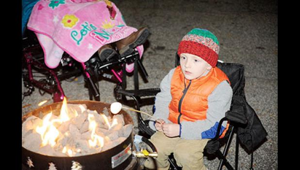 Jason Center roasted marshmallows during the first Rockin' Around Trade event last week. The city will continue Christmas celebrations this weekend with the lighting of the tree in Greer City Park on Friday.
