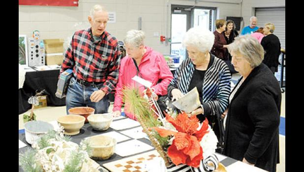 Residents shop the silent auction at last year's annual Big Thursday event.
