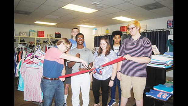 Interact Club President Skyler Tipton cuts the ribbon to officially open Byrnes Boutique, the school's resale shop for ladies. Pictured, left to right, are students Tipton, Jacob Kelly, Nickolaus Loncke, Gabrielle Butz (Interact Club), Kendal Young and Alexander Butz (Interact Club).