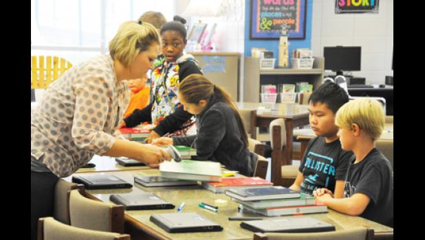 Teachers at Beech Springs Intermediate School in Duncan distributed laptops to students last week. The school piloted a new 1:1 technology program that is being implemented district-wide in 2016.