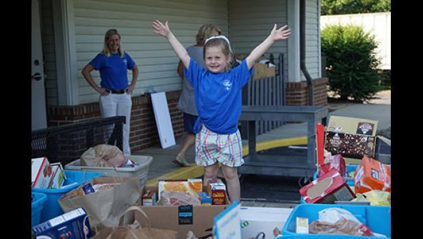 Local six-year-old Ivey Tapp used her birthday to donate some much-needed items to Greer Community Ministries.