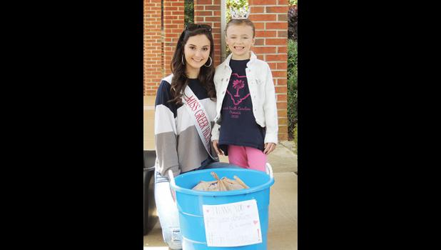 Brannon and Mays collected donations at Memorial Methodist Church last week to fill the Blessing Boxes they created.