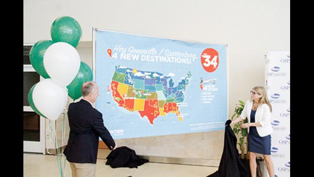 Dave Edwards, GSP's president and CEO, and Tyri Squyres, vice president of marketing for Frontier Airlines, revealed Frontier Airlines four new destinations on Tuesday morning.