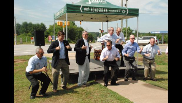 Local officials and Lowes Foods executives celebrated the groundbreaking of a new grocery facility with a 'chicken dance' last week in Greer. The chicken dance is a staple in Lowes Foods stores across the region.