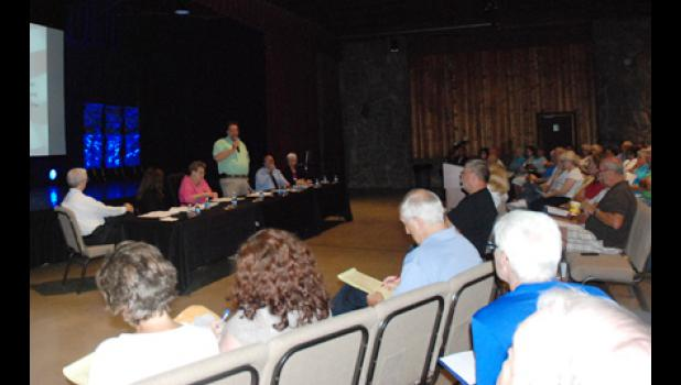 Lyman residents gathered at a special called meeting at Pacific Place Monday night to discuss a possible change in government form.
