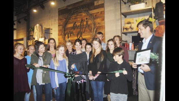 Members of the Greer Chamber of Commerce recently helped Richard and Stephanie Russell cut the ribbon on Madi Boutique, which is now open in Greer.