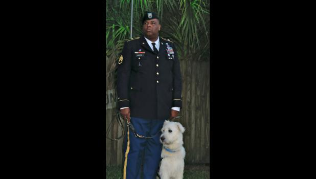 Sgt. Alonzo Lunsford, who was shot seven times in the Fort Hood shooting in 2009, is pictured with his K9s for Warriors dog, Bomber.