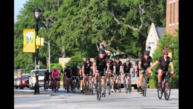 Firefighters and police officers biked through downtown Greer Tuesday morning as part of the Carolina Brotherhood Ride, an event that seeks to support families of first responders killed in the line of duty.