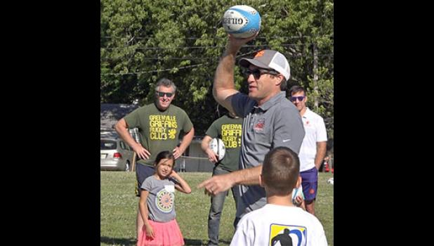 Troy Hall instructs students at a rugby camp in Greer.