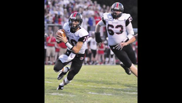 Blue Ridge quarterback Jay Urich scrambles during a win over Eastside Friday night.