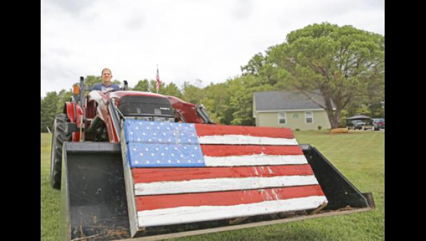 Greer native John Wood had a unique way of honoring veterans during Wednesday's convoy.  He drove his tractor to the edge of his property at Highway 290 to display a painted wooden version of Old Glory he created with his wife for Independence Day.  Wood, whose father was a veteran, said he'd been waiting all day to salute the former servicemen.