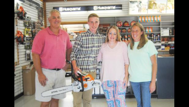 Brian Stanton, owner of McAbee Tractor & Turf Equipment, gave 16-year-old Daniel Moran a new chainsaw last Tuesday.