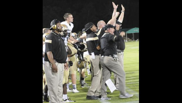 Zach Glidden snagged a game-winning touchdown pass from Mario Cusano as time expired, igniting celebration on the Greer sideline.