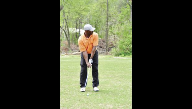 Bralion Hyatt attempts a shot during the GSP International Airport Greer Family Fest golf tournament.
