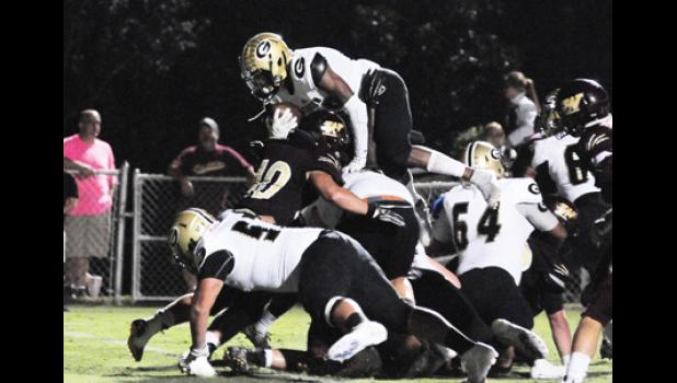 Quay White leaped for a touchdown during Greer's win over Woodruff last Friday night on the road. The Jackets are now on a three-game win streak.