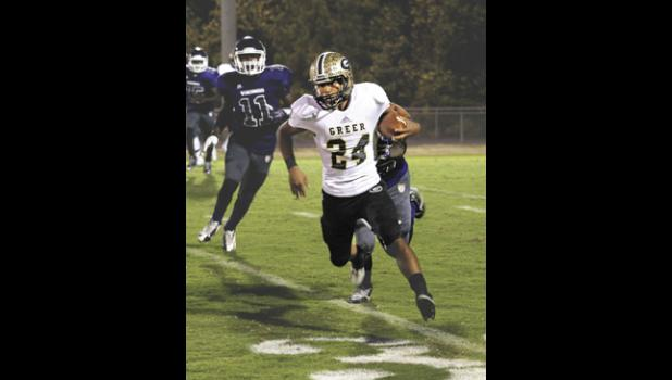 Greer running back Adrian McGee helped his Yellow Jackets remain unbeaten, dashing for a score during a 28-13 win over Emerald.