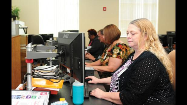 Angela Eberly takes a training course in office programs at the Bryant Center Monday afternoon.