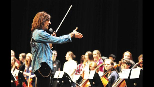 Mark Wood, known for his work with the Trans-Siberian Orchestra, spent last Thursday and Friday with students in Spartanburg District Five, teaching them how to play rock music on their stringed instruments.