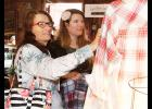 Sue Kinard, left, and her daughter, Shellie Kinard, shop for shirts at the Vintage Fall Fest on Saturday at the Dutch Barn in Greer.