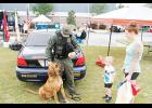 Greenville County Deputy Chris Robinson and bloodhound, Rusty, greet Lauren Pitman and her son, Carson, during the Sgt. Brian Donnelly Safety Awareness Day event at Eastside Family YMCA in Taylors Saturday.