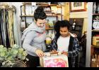 Sarah and Ivanka Evans look at albums during the Pop Up Shop with Iviva at the Main Collective, located at 1 E Main St, Taylors.