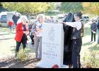 Bob Starliper, Commander of American Legion Post 115 Greer, unveiled a new monument to honor WWI veterans on Saturday at the Greer Veterans Memorial Park while Charlotte Koehler (left) and Karen Albert (right) watch.