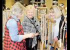 Gina Bailey, Sylvia Norton, and Shea Shealy, l to r, look at jewelry during the Blue Ridge Middle Shop the Ridge event last week.
