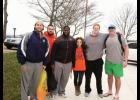 "Miss Greater Greer 2015 Anna Brown, center, with the Clemson offensive line. The players participated in Brown's fundraiser ""Freezin' for a Reason."""