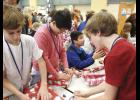 Riverside Middle School Beta Club members sponsored families through the Salvation Army and wrapped the many gifts that were donated.
