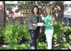 Citizens Building & Loan Executive Vice President Jennifer Jones, left, presented Cathy Neely of Greer Christian Learning Center with a check for $10,000 last week.
