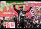 Martin Truex Jr., driver of the  No. 78 Furniture Row/Denver Mattress Toyota, celebrates in Victory Lane after winning the Monster Energy NASCAR Cup Series Tales of the Turtles 400 at Chicagoland Speedway on Sept. 17 in Joliet, Illinois.