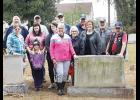 Members of American Legion Post 115 and other volunteers cleaned up the cemetery near Greer City Park on Saturday.