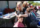 Kind cuts: Dominick Jackson, bottom, receives a free hair cut from Arianna McAbee at Greer Relief's annual Care Fair.