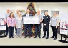 CresCom Bank's Jim Boyd presented a $3,000 check to GPCAAA president Dale Haule.