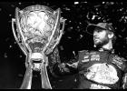 Martin Truex Jr., driver of the #78 Bass Pro Shops/Tracker Boats Toyota, celebrates with the trophy in Victory Lane after winning the Monster Energy NASCAR Cup Series Championship and the Monster Energy NASCAR Cup Series Championship Ford EcoBoost 400 at Homestead-Miami Speedway on November 19, 2017 in Homestead, Florida.