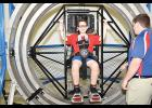 Jackson Demumbreum gets strapped into the Gyrosphere at the U.S. Space and Rocket Center during Space Camp. The device simulates the force of a moving object.