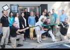 Jeff and Ann Brannon cut the ribbon at their new location last Thursday alongside the Integrity Blinds and Shutters team as well as family and friends.