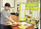 A River Ridge fourth grade student invented the 'Medi-Dri-Line,' a device inspired by his younger sister's experience with a broviac line during her battle with cancer.