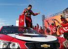 Kyle Larson, driver of the #42 Cars 3/Target Chevrolet, celebrates in Victory Lane after winning the Monster Energy NASCAR Cup Series FireKeepers Casino 400 at Michigan International Speedway on June 18 in Brooklyn, Michigan.