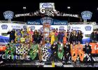 Kyle Busch, driver of the No. 18 M&M's Halloween Toyota, and his crew celebrate with the trophy in Victory Lane after winning the Monster Energy NASCAR Cup Series First Data 500 at Martinsville Speedway on October 29, 2017 in Martinsville, Virginia.