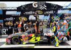 Jeff Gordon, driver of the No. 24 Axalta Chevrolet, celebrates in victory lane after winning the NASCAR Sprint Cup Series Pure Michigan 400 at Michigan International Speedway.