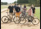 The Team Sports class at Greer High stands with some of the recent bike donations.