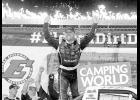 Matt Crafton, driver of the No. 88 Ideal Door/Menards Toyota, celebrates after winning the NASCAR Camping World Truck Series 5th Annual Dirt Derby 150 at Eldora Speedway on July 19 in Rossburg, Ohio.