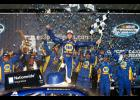 Chase Elliott, driver of the No. 9 NAPA Auto Parts Chevrolet, celebrates after winning the NASCAR Nationwide Series EnjoyIllinois.com 300 race at Chicagoland Speedway.