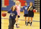 Jenny Taylor demonstrates proper technique during a Riverside basketball practice.