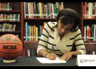 Courtney Robinson signs to play basketball with Wingate next season.
